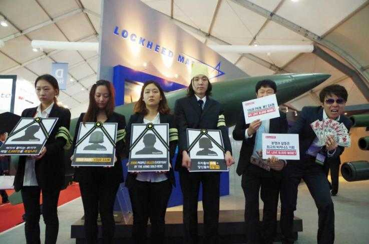 South Korean activists disrupt an arms fair in Seoul, South Korea, with signs and fake money
