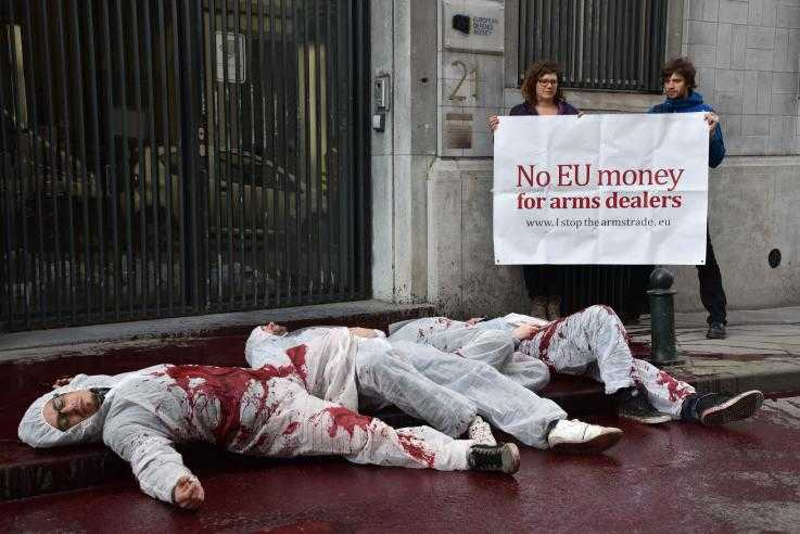Activist lie on in a pool of fake blood