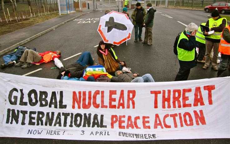 A blockade at a nuclear weapons factory, with a big banner