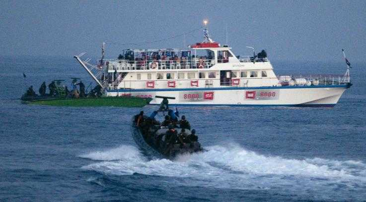 Israeli troops approach one of the 2010 Freedom Flotilla boats