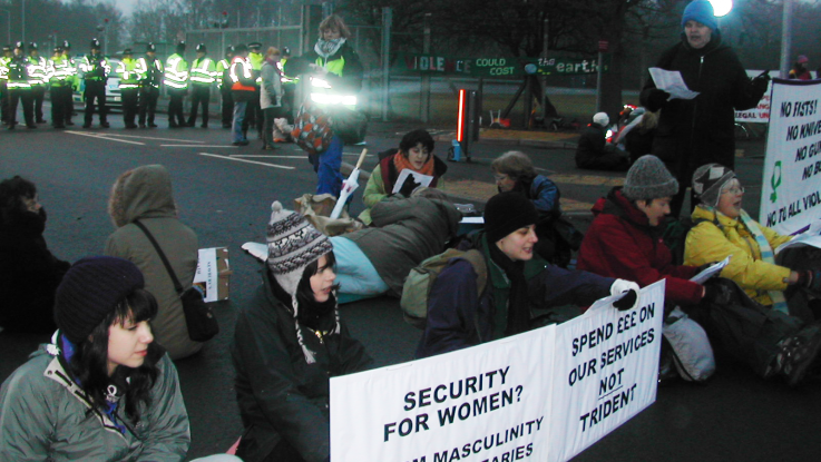 A group of women activists blockade a nuclear weapons factory in the UK.