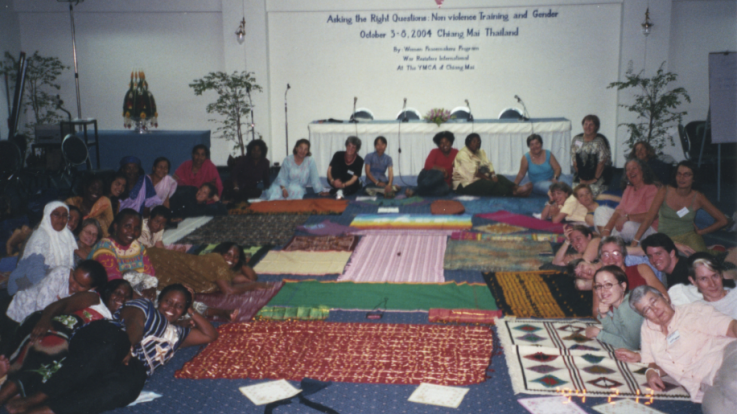 A group of people attending a nonviolence training focusing on gender