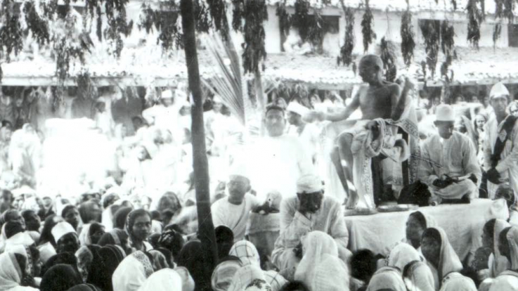 Gandhi gives a talk to a crowd