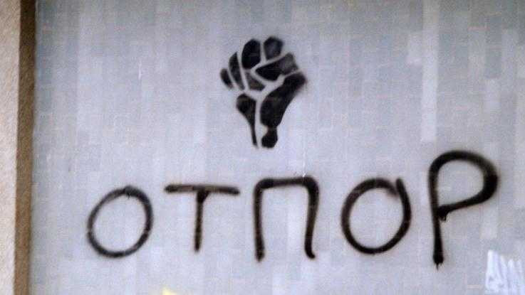 The Otpor logo painted on a wall