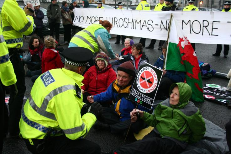 A group of protesters working together to blockade a nuclear weapons factory in the UK