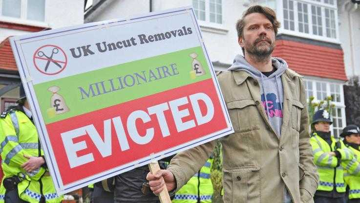"UK Uncut action, ""evicting"" millionaires and tax dodgers"