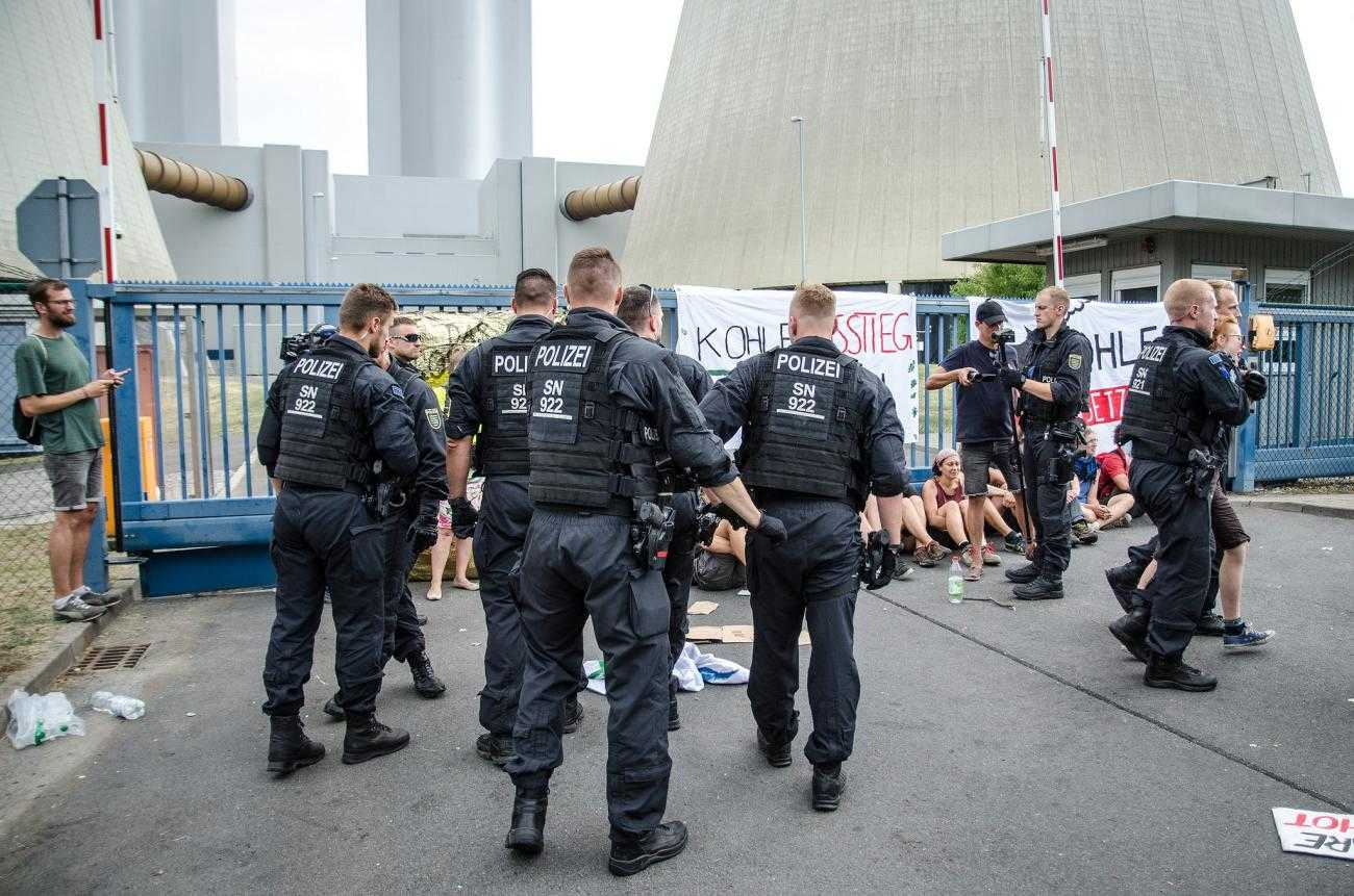 A large group of police officers prepare to remove activists blockading a coal mine in Germany