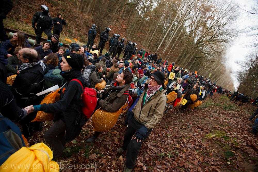 A large group of people attempt to blockade the Castor nuclear waste train