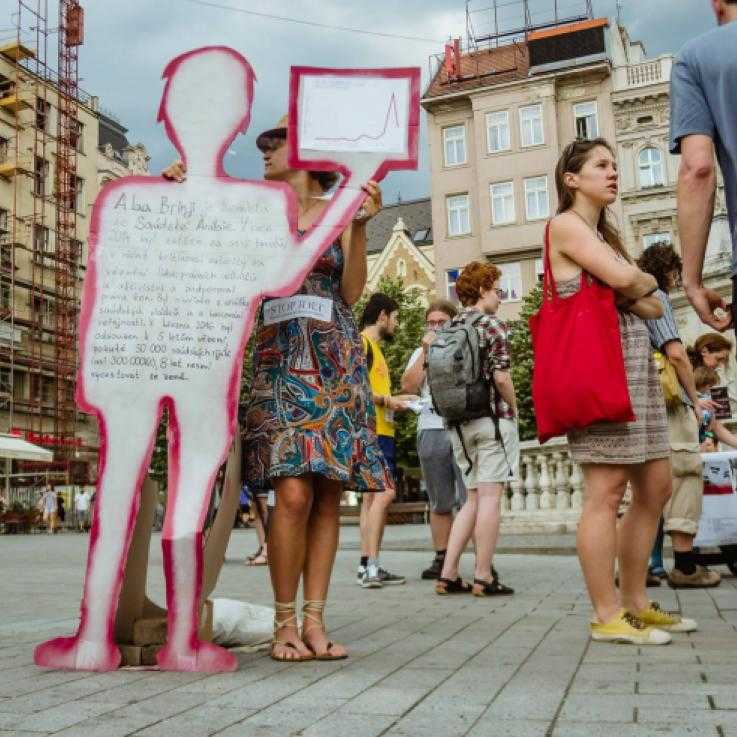 Activists in the Czech Republic protest against the IDET arms fair with cutout people with information about the arms trade written on them